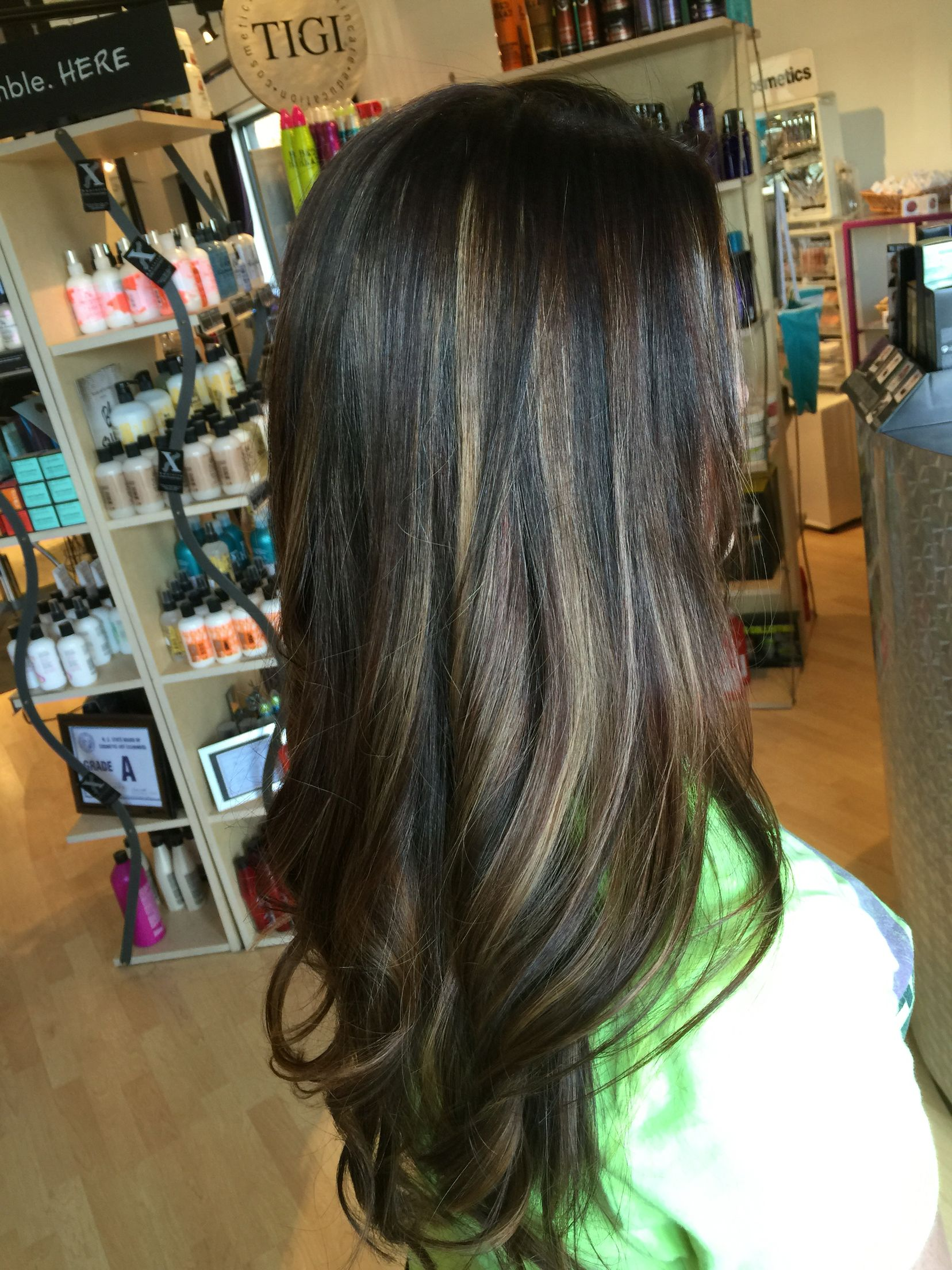 Chocolate brown with dark brown lowlights and added pieces of blonde through the back. Color melt brown/blonde(bronde). By Denise Suttlemyre @Xquisite Salon &Spa