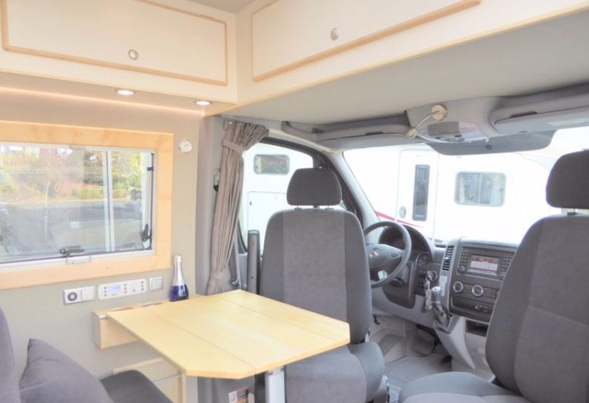 Folding Table And Forward Interior Of Mercedes Sprinter Camper Van From CS Reisemobile