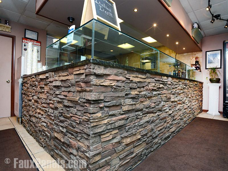 Fattusco's in Northport, NY, used our faux stone siding panels in Regency Stacked Stone Earth to cover their counter.