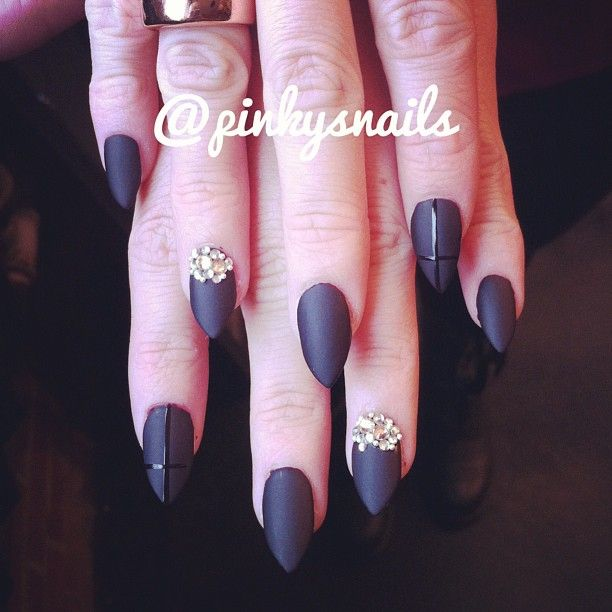 A set of glam matte stiletto acrylics with rhinestone accents by @Esther Aduriz Nieuwenhuis!