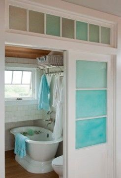small bathroom with sliding doors, such a cute idea when you have an ...