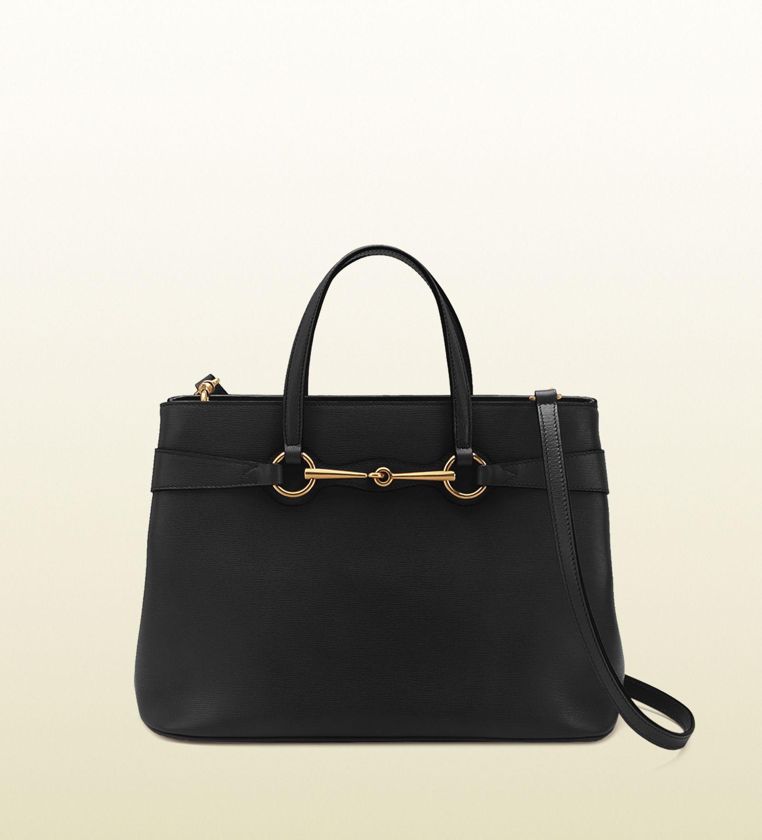 super popular 49110 ebc90 borsa shopping in pelle nera con dettaglio morsetto Gucci ...
