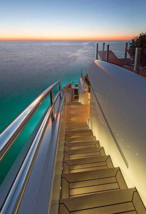 Walking down the side of the yacht.