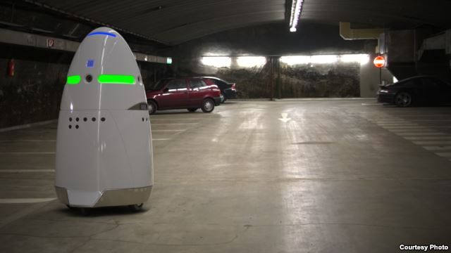 Microsoft Employs Robots as Security Guards ! This photo from California manufacturer Knightscope shows the company's K5 security robot keeping tabs on a parking area.