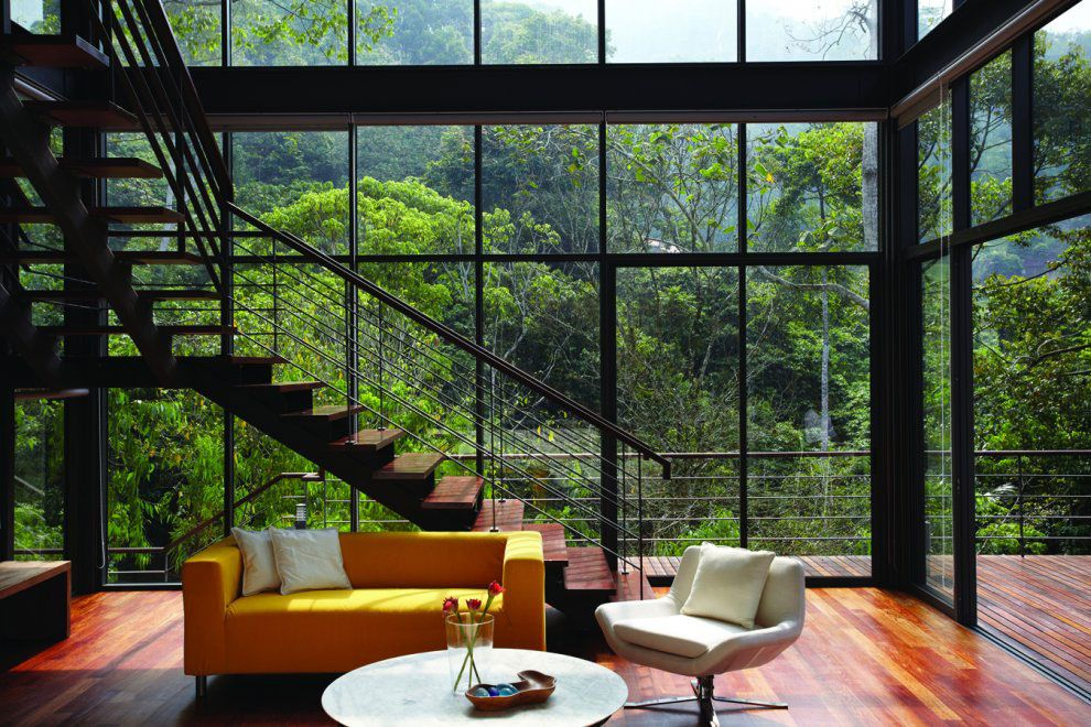 tropical living room in malaysia small open plan decorating ideas modern hillside homes space glass walls home janda baik