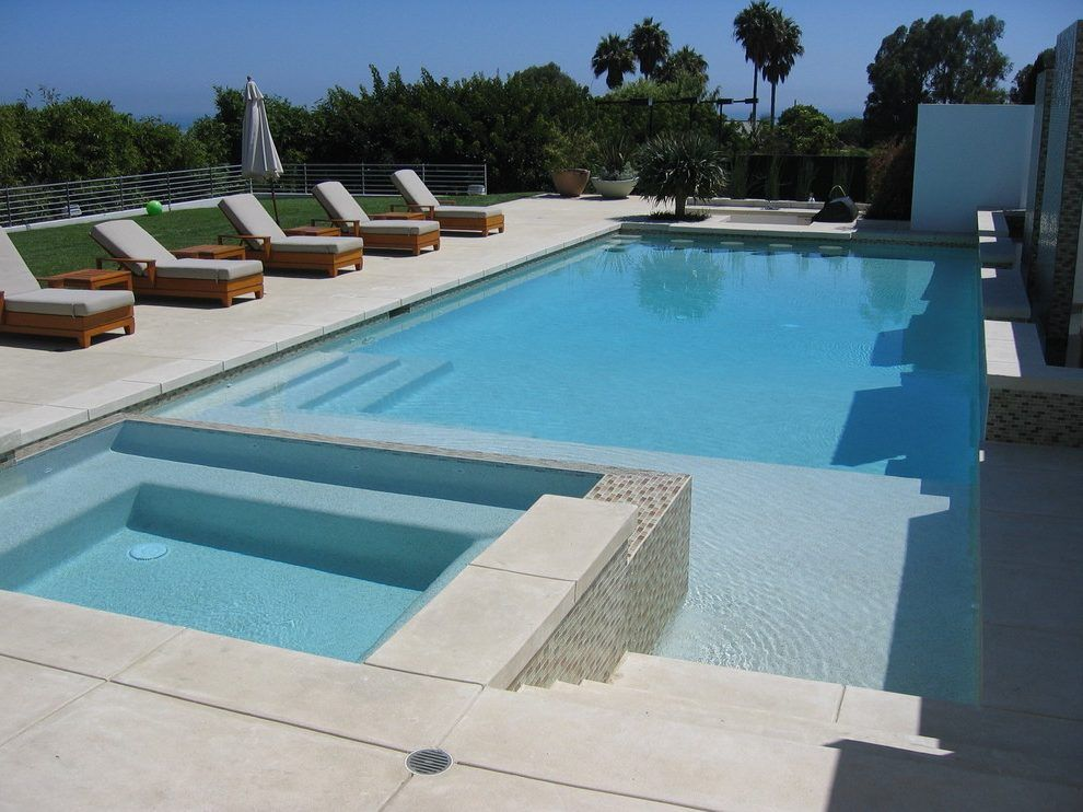 brushed concrete pool deck pool contemporary with spa modern outdoor dining tables