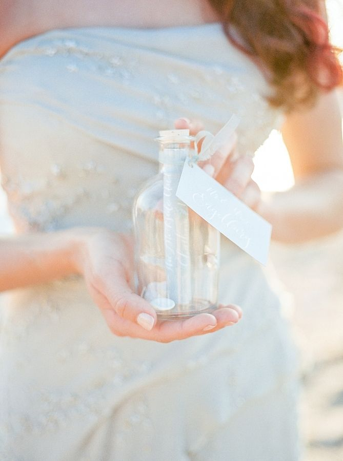 Sweet message in a bottle vows: http://www.stylemepretty.com/connecticut-weddings/new-haven/2015/10/06/romantic-oceanside-elopement-in-connecticut/   Photography: Callie Manion - http://www.calliemanionphotography.com/