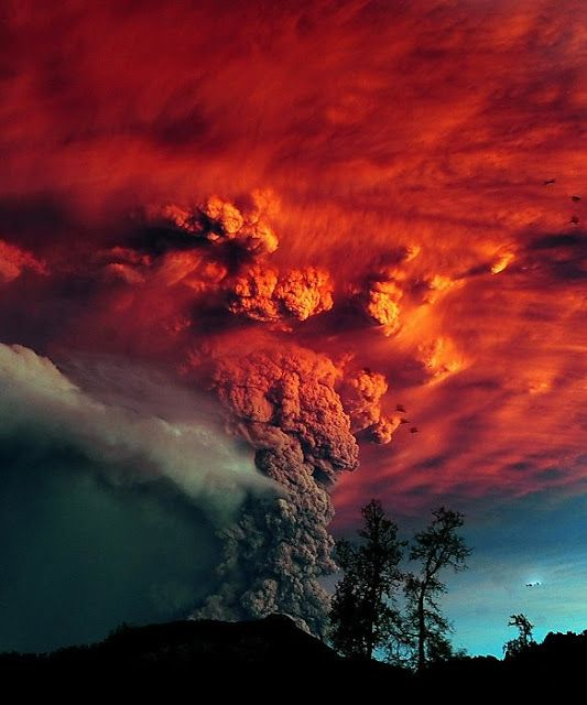 : Puyehue volcano eruption, Argentina ...what's that black glowing object off to the right in the sky?
