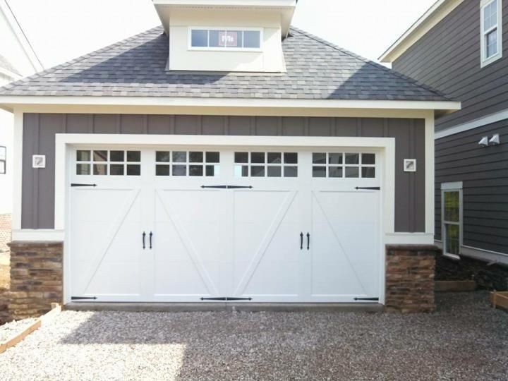 Good Coachman White Garage Door With Long Panel Windows And Black Iron Hardware  ~ Great Pin!