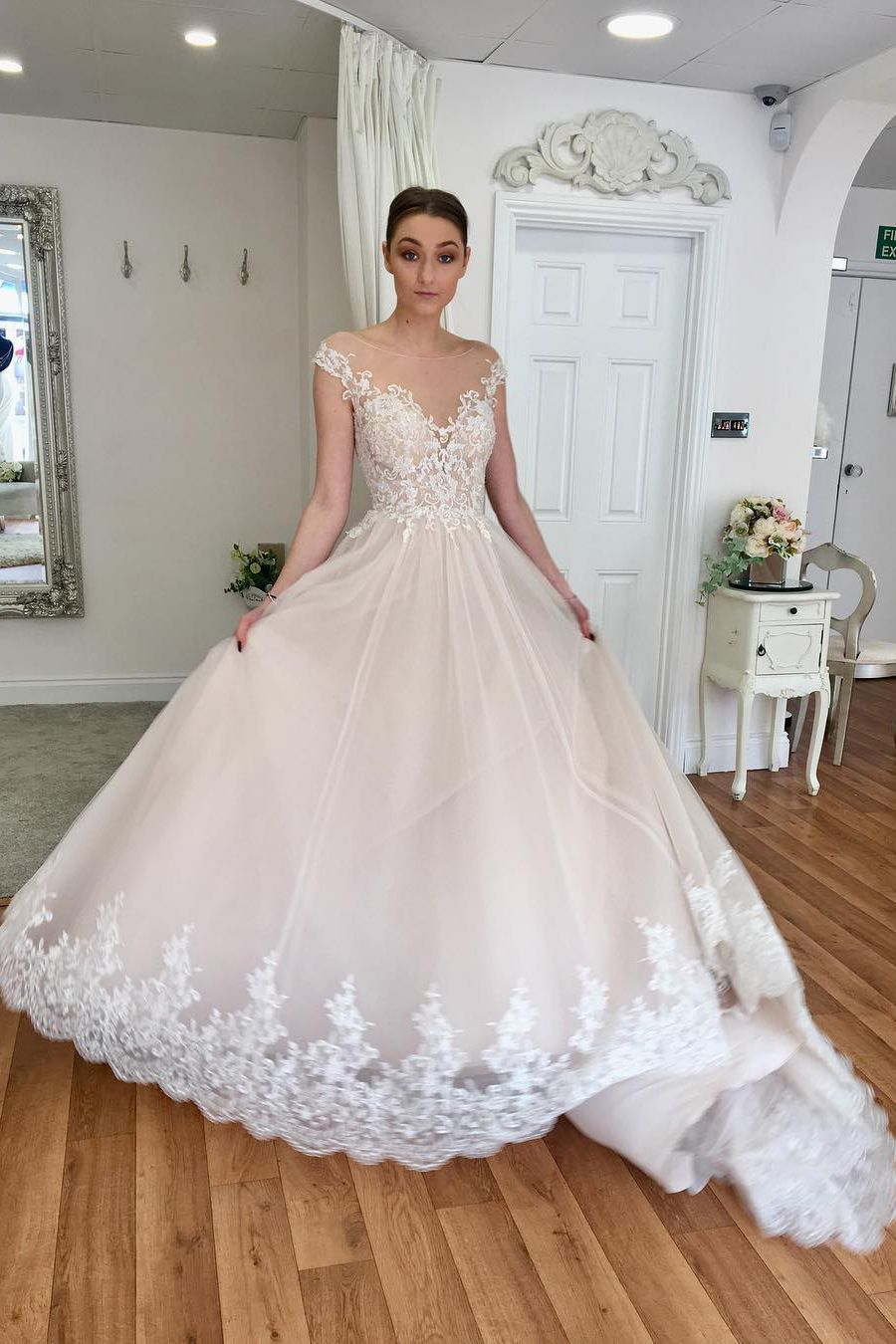 Ivory long wedding dress with cap sleeves