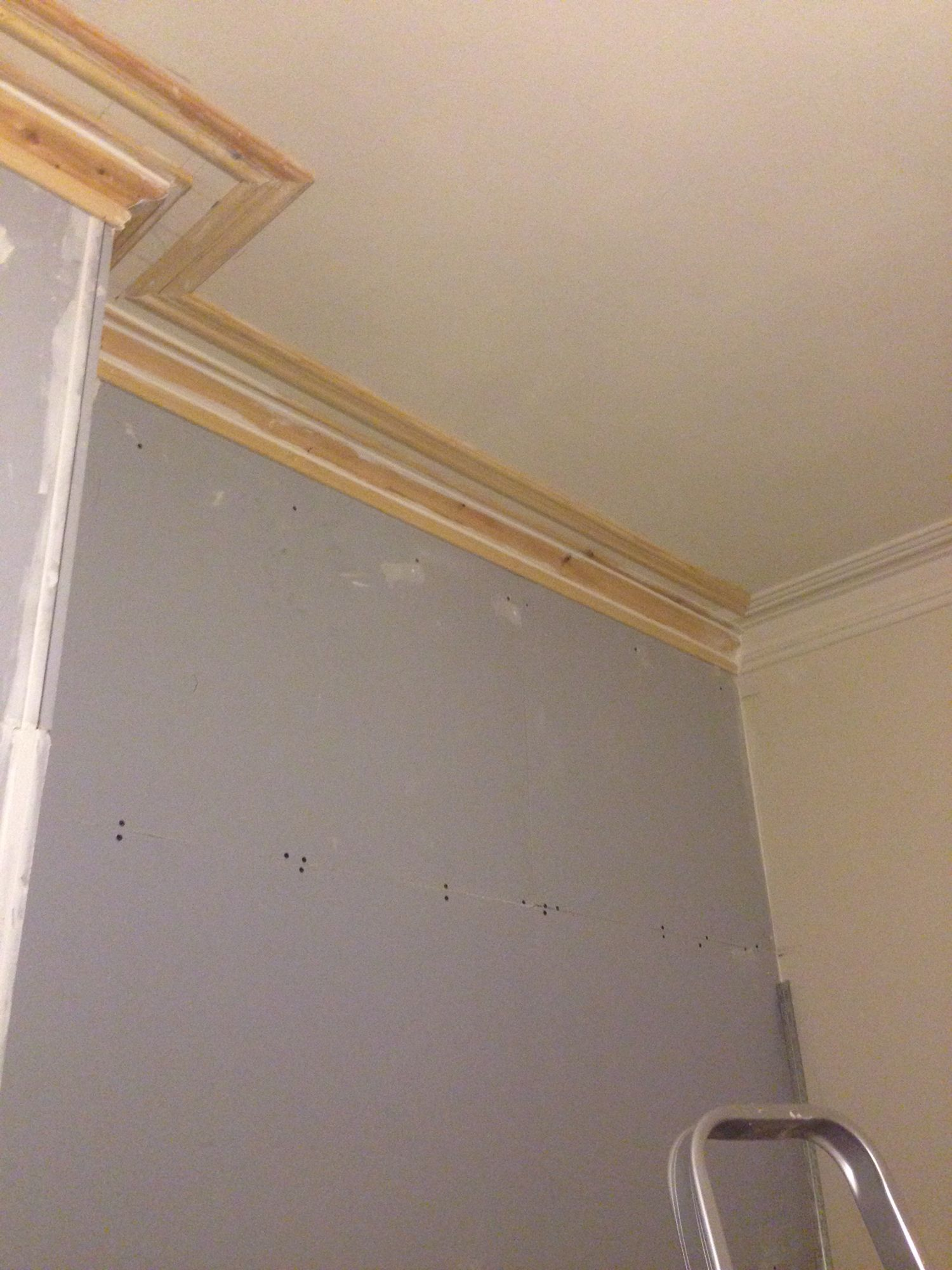 New soundproofed party wall with timber cornice built to match ...