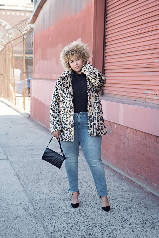 4297010584 Fierce leopard coat, blonde afro, black shirt tucked into light skinny  jeans + black pumps. Body positive plus size fashion.