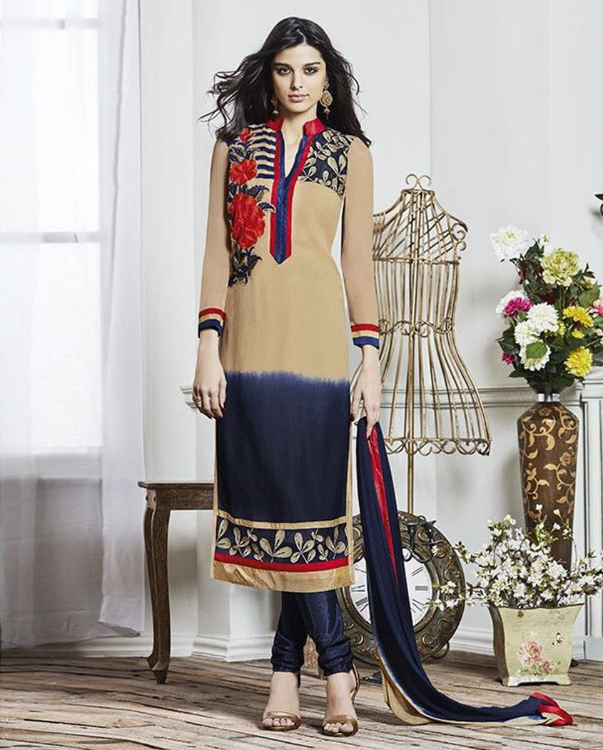 Beige and blue shaded suit with flora embroidered yoke   1. Beige and blue georgette embroidered suit2. Resham sequins floral embroidery with golden gotta border on dupatta3. Comes with matching santoon bottom and chiffon dupatta4. Can be stitched upto size 44 inches  and length 48 to 50