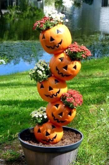 Pumpkin totems, stacks and towers Pumpkin tipsies, explained - pinterest halloween yard decor