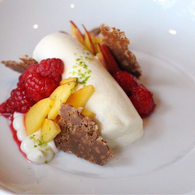 Greek yogurt panna cotta, fresh raspberries, apricots, caramelized rice crisps, lime zest.