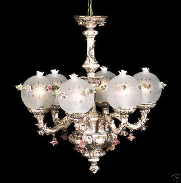 6 arm white crystal chandelier with glass flowers on the gold base