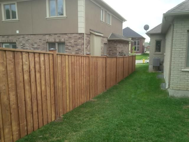 Sienna brown immitation board on batton fence wood for Brown treated deck boards