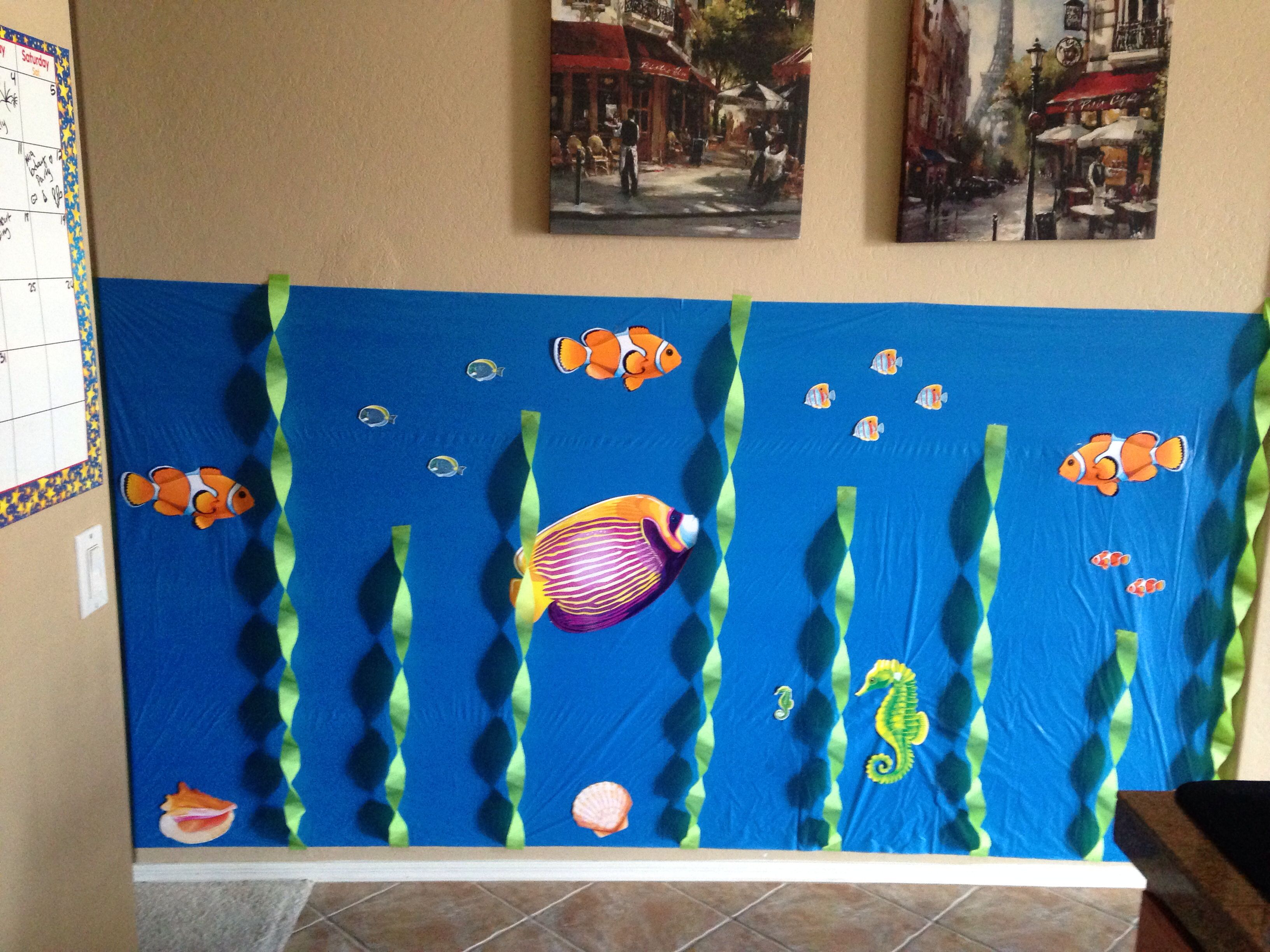 Underwater nemo party wall decoration using a dollar store plastic underwater nemo party wall decoration using a dollar store plastic blue tablecloth amipublicfo Image collections