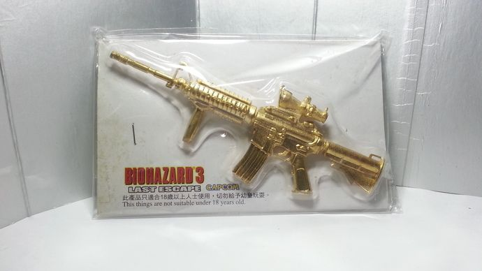 Hong Kong Capcom Comic BIOHAZARD 3 Last Escape Promo Assault Rifle Gold Metal Toy Resident Evil by mycoffeeboy
