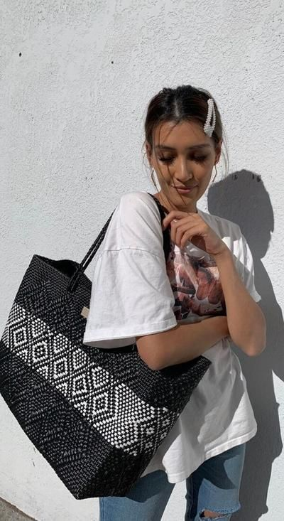 Turn heads with chic Rosa Mexican Plastic Woven Tote Bag in black and White made of recycled plastic and handmade in Mexico. Incredibly spacious and easy to clean, our large oversized woven bags are perfect for travel, shopping, the market and summer beach trips. CHUCHKA is a modern fashion accessories brand based out of Bondi Australia for everyday stylish women and teens. #mexicanbags #handmade #woven #beachbag #shopperbag