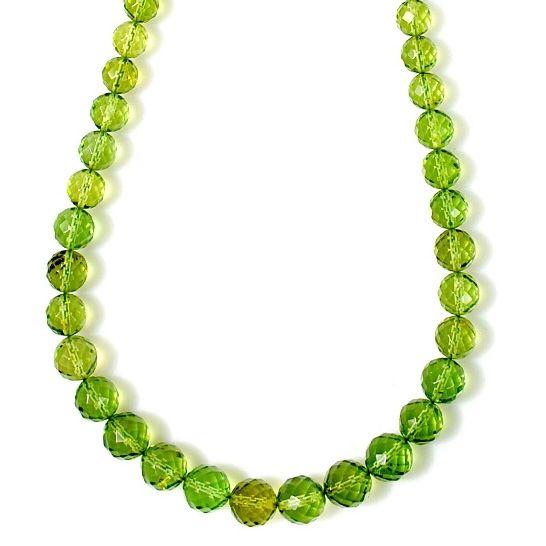 Collier perles ronds facettés en Ambre Caraïbes vert. Prix: 141€