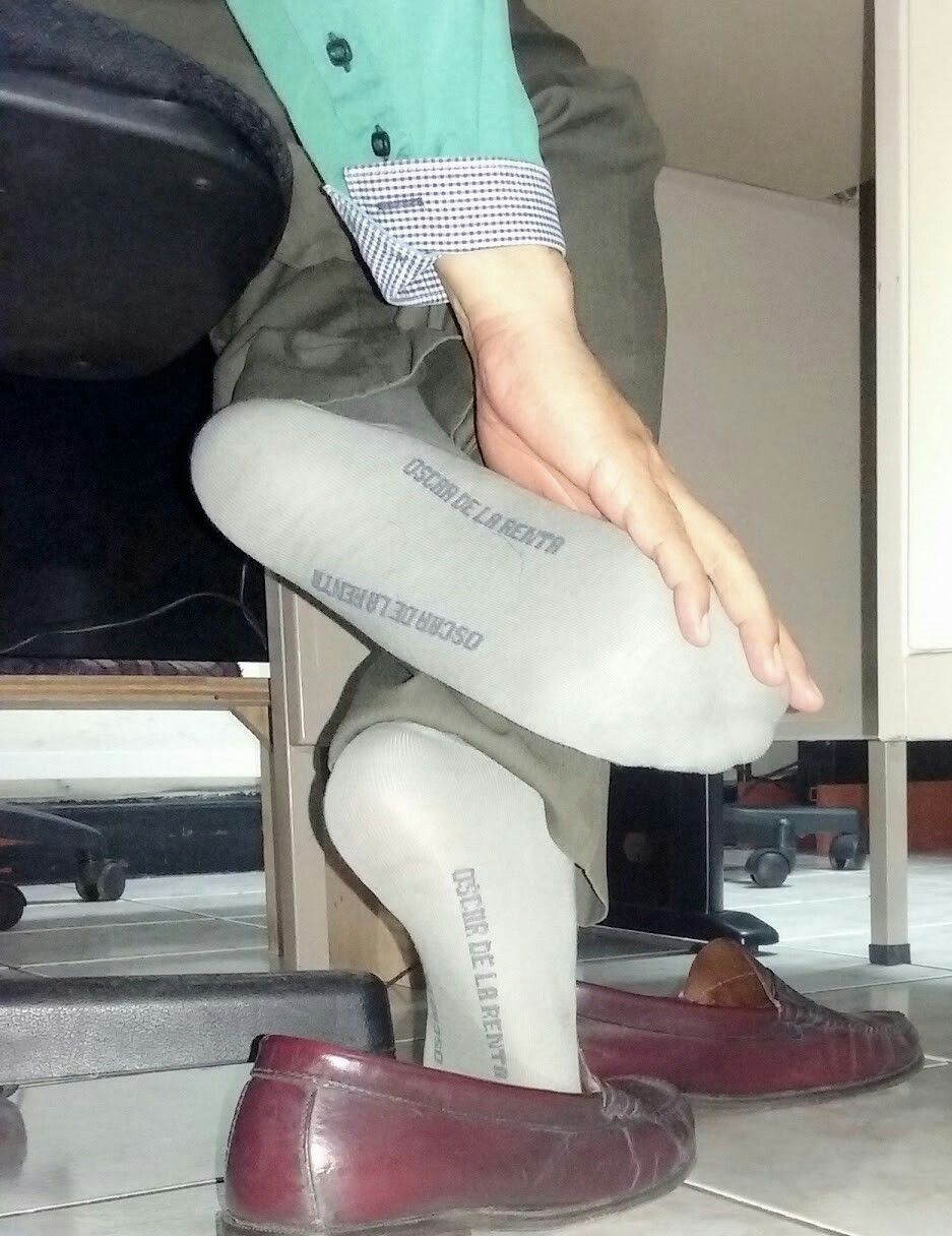Male shoeplay at desk