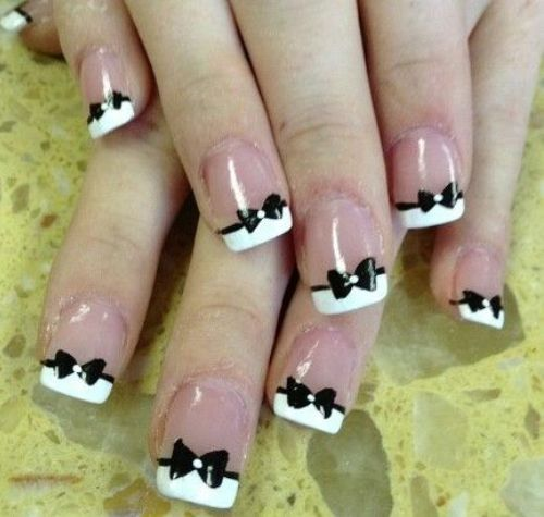 Black And White Nail Polishes With Bowtie Accents Tips