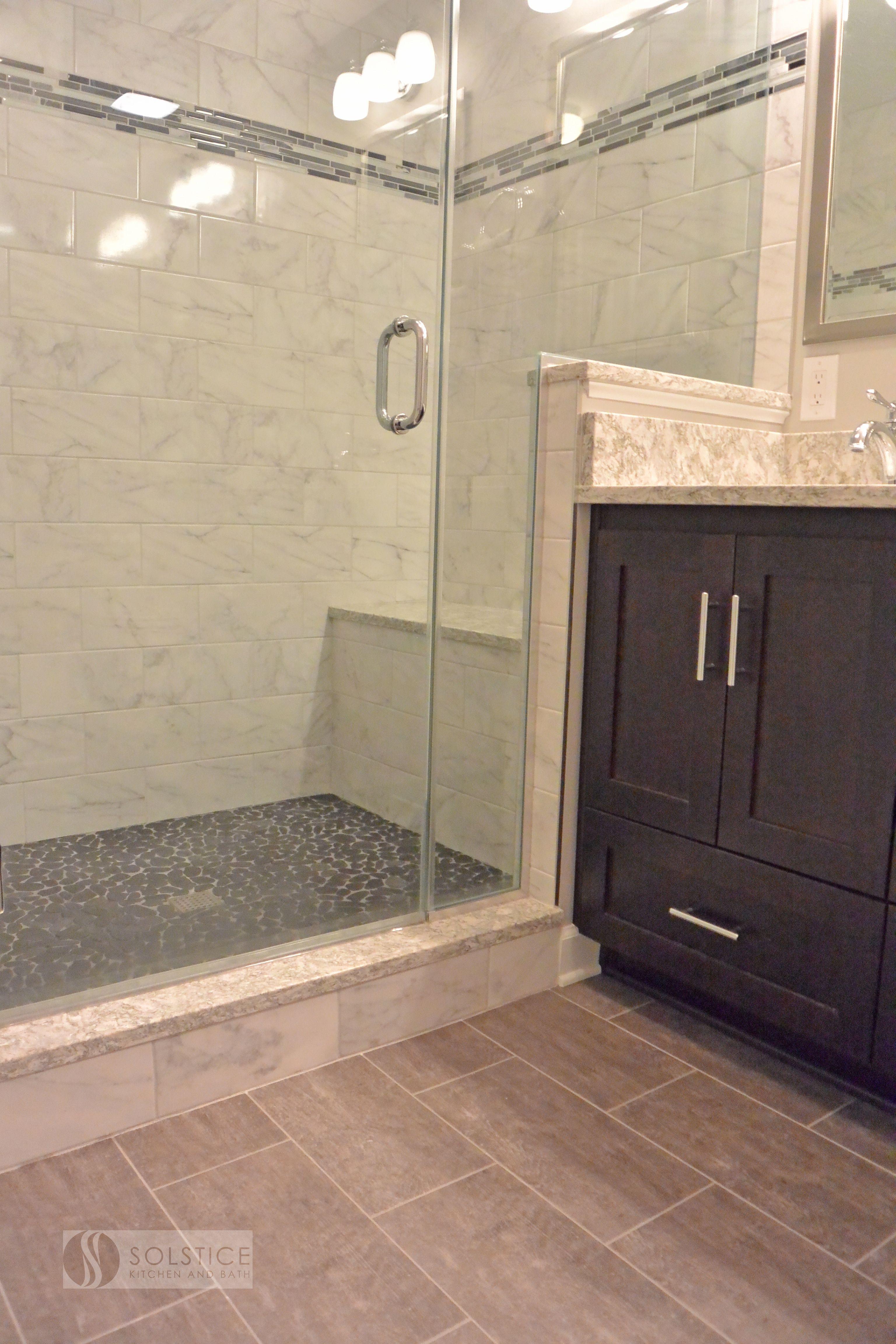 This Warm Transitional Bathroom Design In A Walden Garage Townhome In Crofton Combines A Frameless Trendy Bathroom Tiles Stone Shower Floor Best Bathroom Tiles