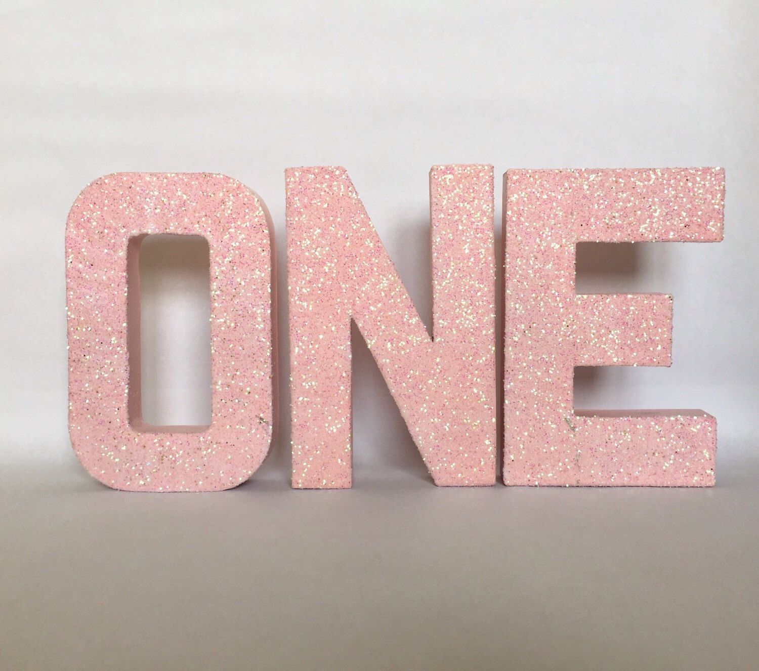 Pink glitter stand up quotonequot letter sign first birthday for Glitter cardboard letters