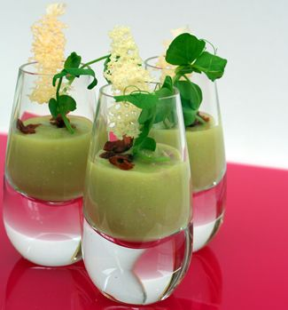 Shot of potato and watercress soup with a black pepper for Wedding canape ideas