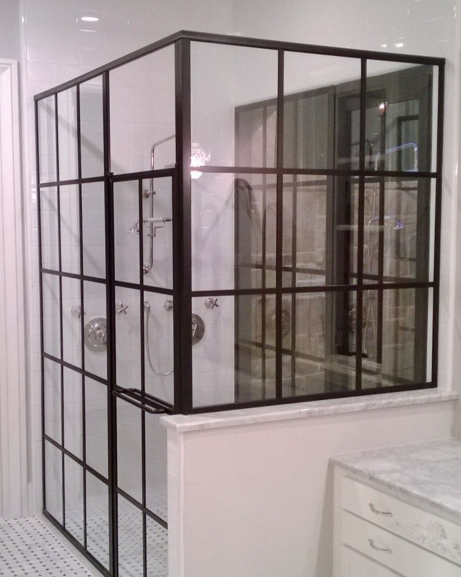 Frameless glass storefront door - Black Metal Frame With Crossbars To Match The Storefront Application Leading To The Outside Shower