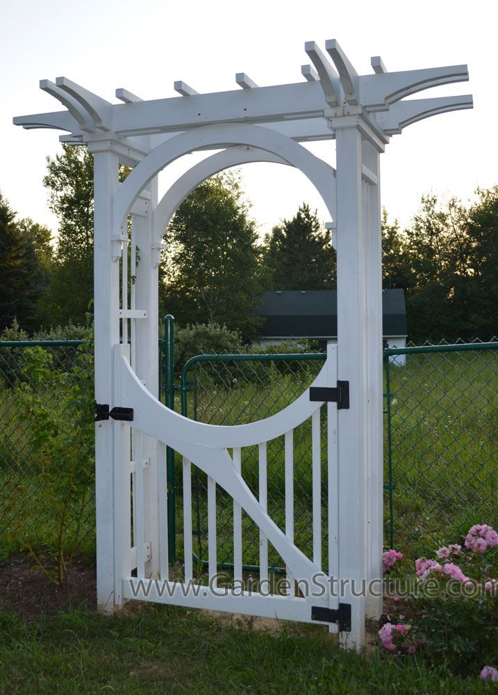 A garden arbor with inner arch bracing and custom gate for Garden gate arbors designs