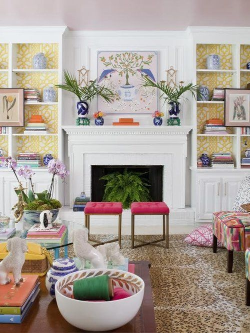 The Pink Clutch Palm Beach Chic Living Room With Bold Colors Pops Of Bookcases Wallpaper Leopard Rug And Blue White