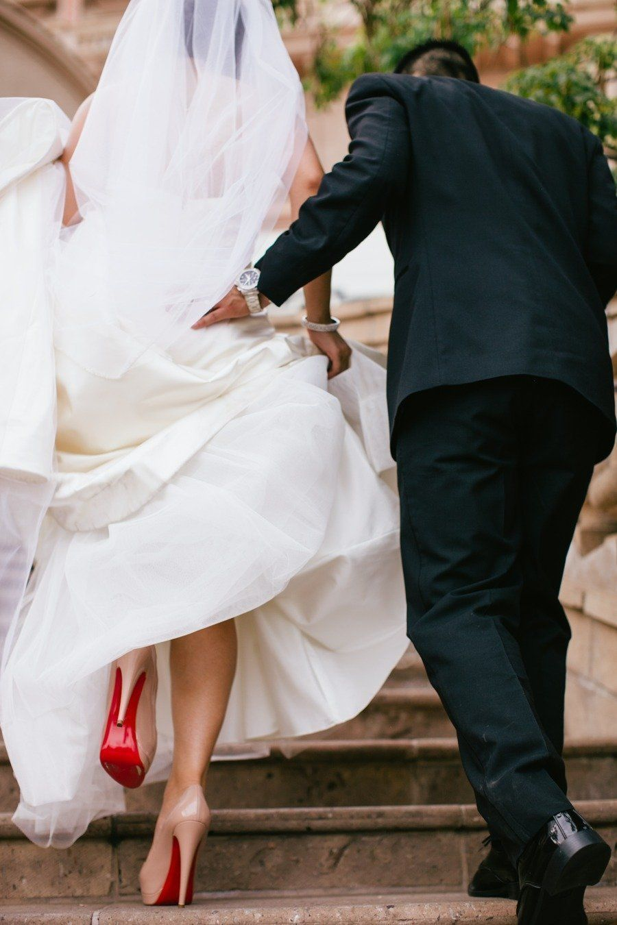 Pretty is the bride in her pink christian louboutins and red soles