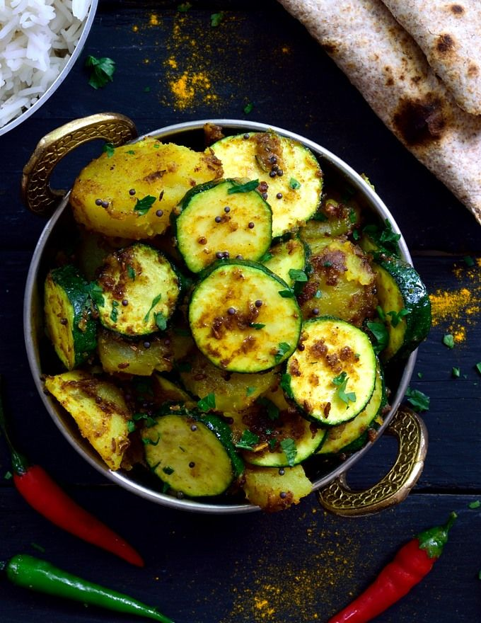This Simple Dish Of Indian Spiced Potatoes And Zucchini Is A Total Flavour Bomb Two Main Potato Recipes Side Dishes Zucchini Side Dishes Vegetable Side Dishes