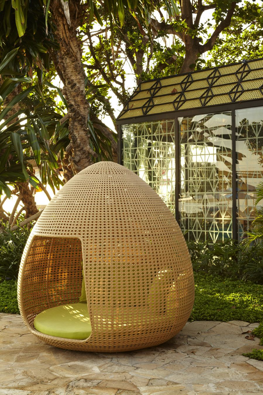 Cocoon like outdoor furniture made out of synthetic rattan for both parents and children to chill