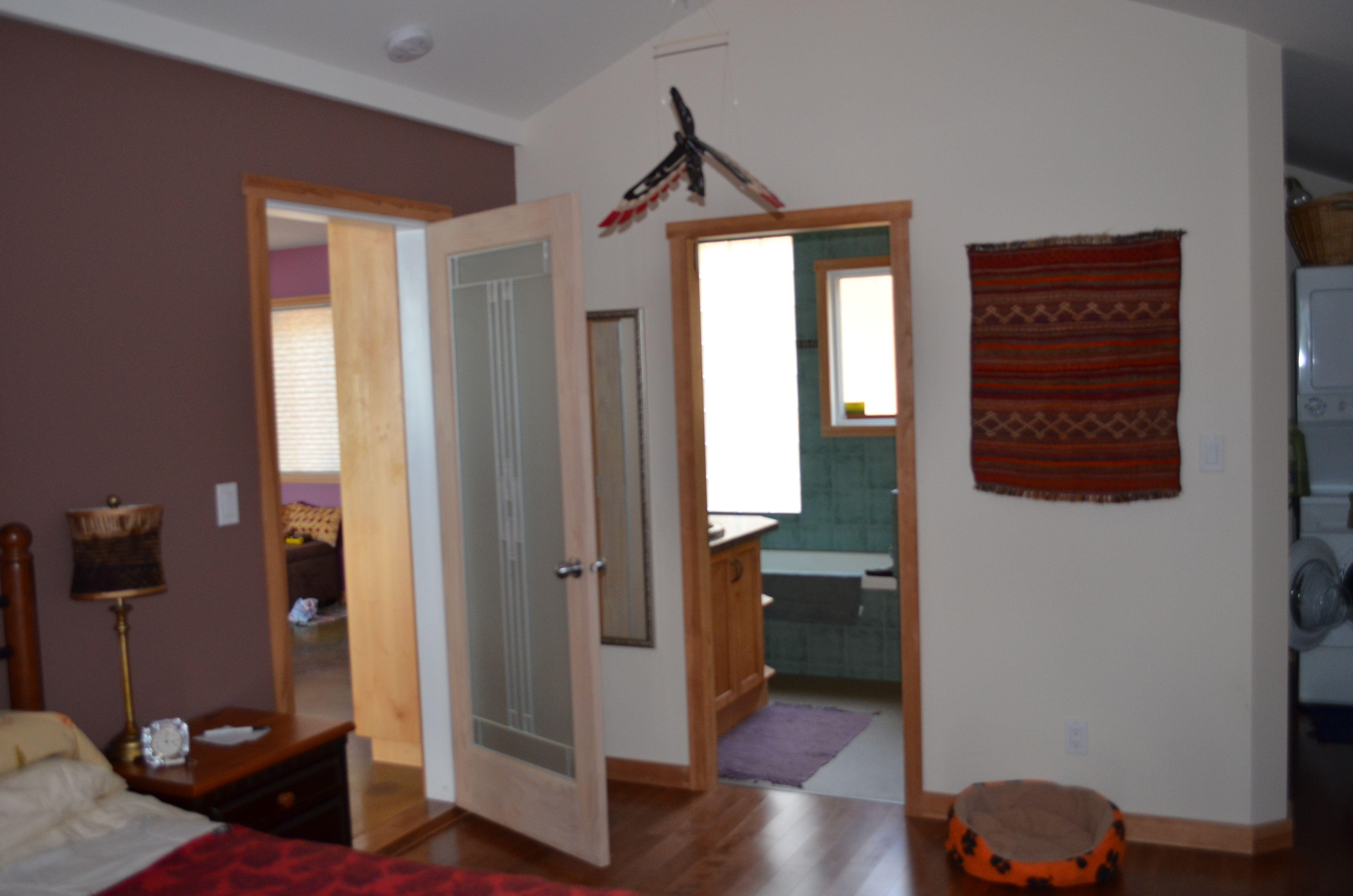 Single car garage conversion into bedroom, bathroom