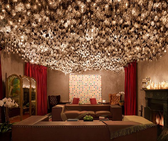 The Drawing Room at The Gramercy Park Hotel in New York City is an art lover's dream with about 4,000 lightbulbs suspended from the ceiling!