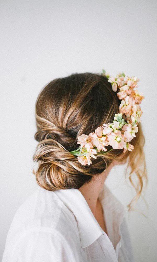 Rustic updo wedding hairstyle - medium long hair, floral, elegant. See more: http://www.weddingforward.com/romantic-bridal-updos-wedding-hairstyles/ #weddinghairstyles #bridalhairstyles