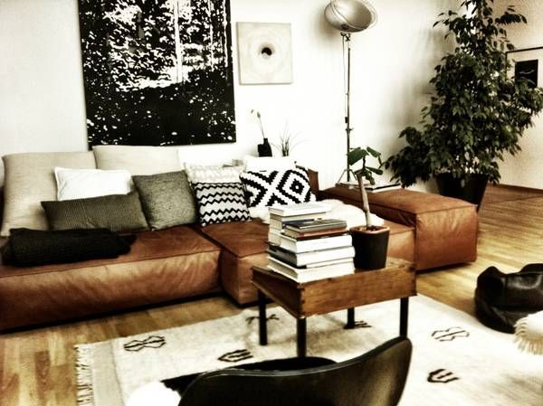living room grey couch black white tan leather boho styling ...