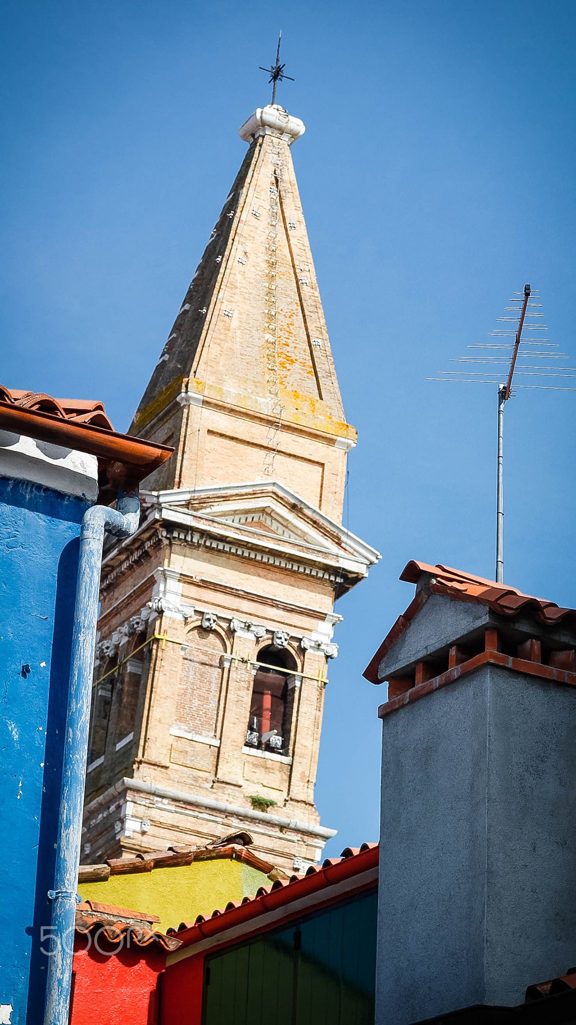 Old bell tower in balance bis - The old bell tower of Burano which is also in balance like the famous tower of Pisa.
