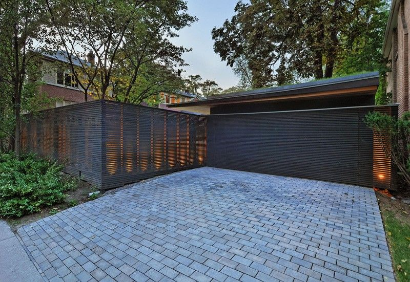 Before  After \u2013 A fence and garage update for a home in Toronto