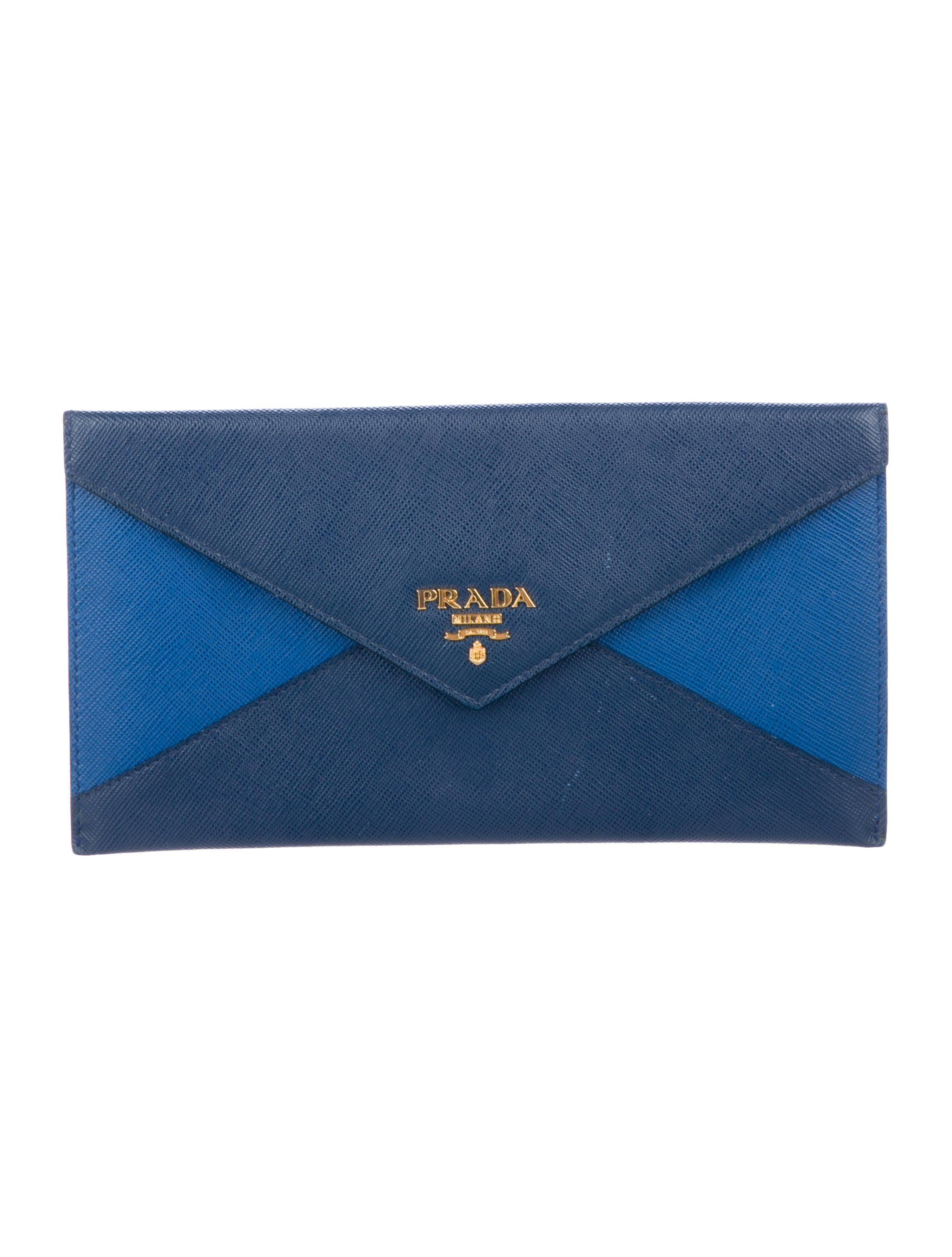 6c90528458ebd6 Blue and navy Saffiano leather Prada envelope wallet with gold-tone  hardware, exterior zip