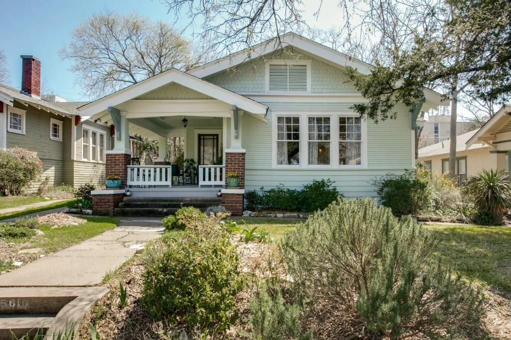 This is adorable, talk about curb appeal! // Mint, craftsman-style home with white accents, great landscaping, wonderful front porch