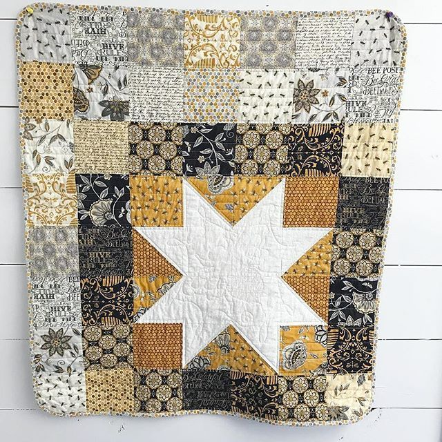 This Big Star Charm quilt is such a beautiful gift with personal touches!  #Repost @jafarms ・・・ The last gift to post. This wallhanging was made for a beekeeper with the Bee Creative line I ordered on sale at @missouriquiltco last month. If you look closely, you can see a bee quilted in the star. This was the first time I've attempted #freemotionquilting a drawn out pattern. I was nervous! (She's the queen ) #msqcshowandtell #dailydeal #quilt