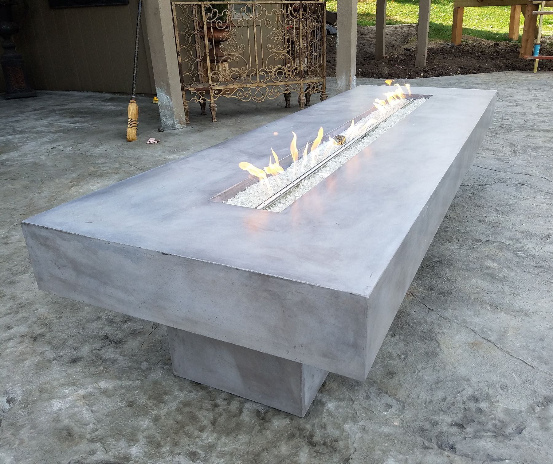 Gray stained rectangular concrete fire pit fire pit materials
