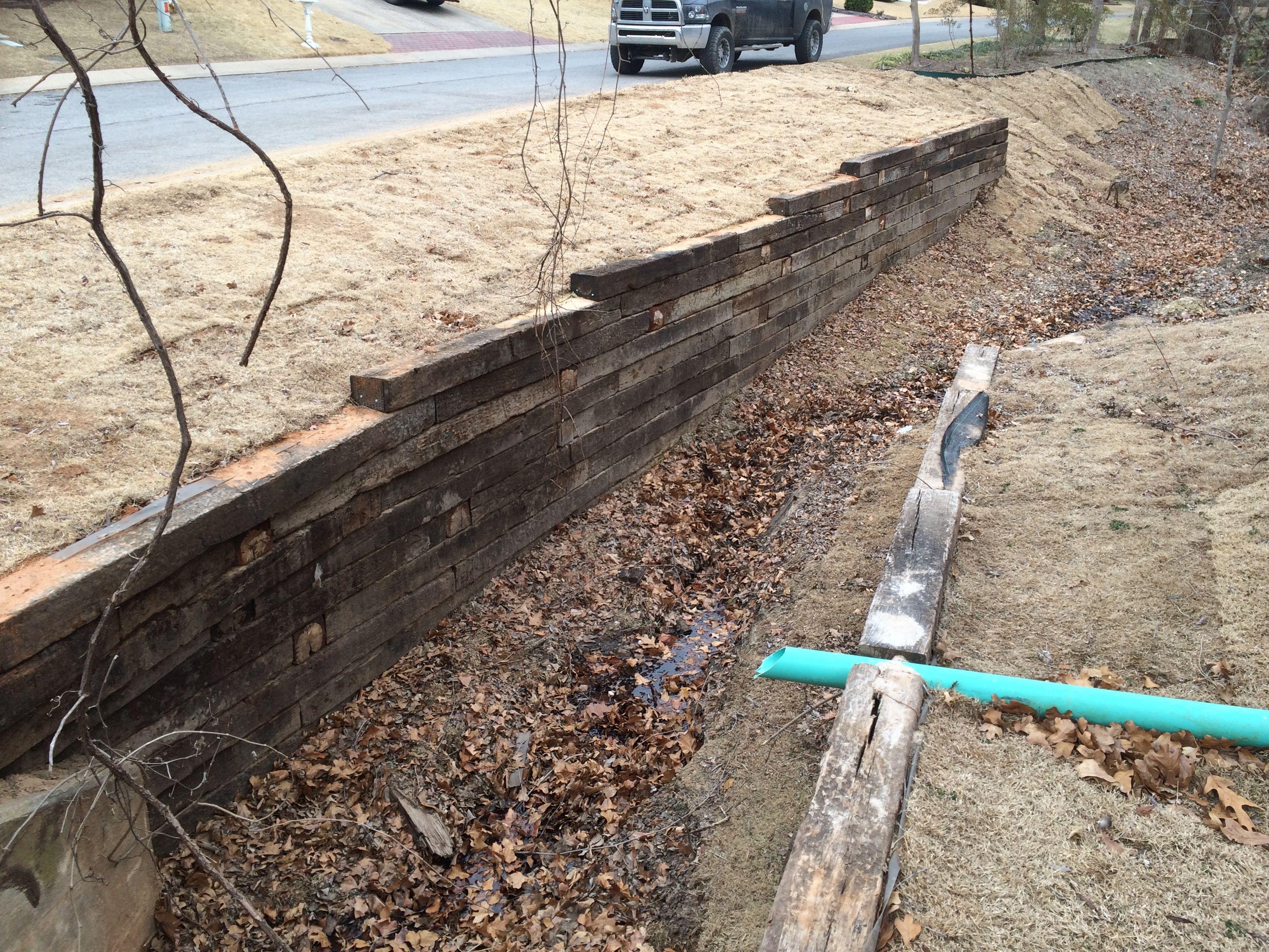 Railroad Tie Retaining Wall Installation In Tulsa Railroad Tie Retaining Walls Hardscaping Landscaping Railroad Tie Retaining Wall Hardscape Landscape Walls