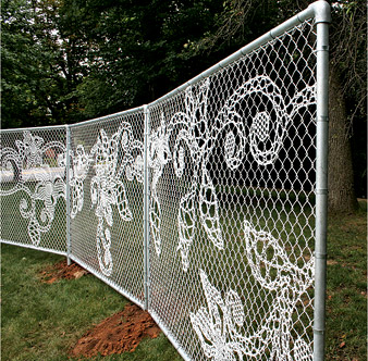 yarn bombed fence, so cool!