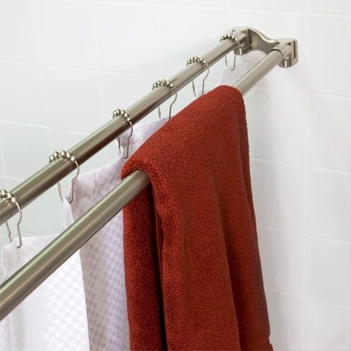 Double shower curtain rod. Great space saver. Could be DIY-ed with 2 tension rods.