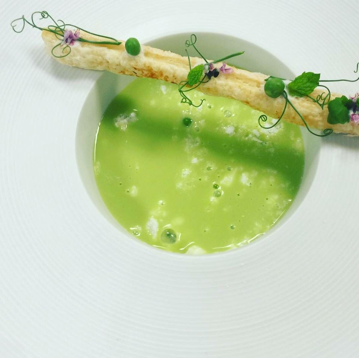 Final dish for my Advanced Culinary:Chilled pea soup with puff pastry  prosciutto tuile and butter milk snow